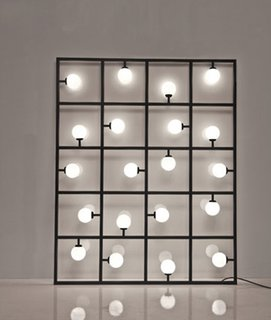 Atelier Areti's sculptural grid-like Squares floor/wall lamp is designed to lean against the wall, but can also be attached to the wall or suspended from the ceiling.