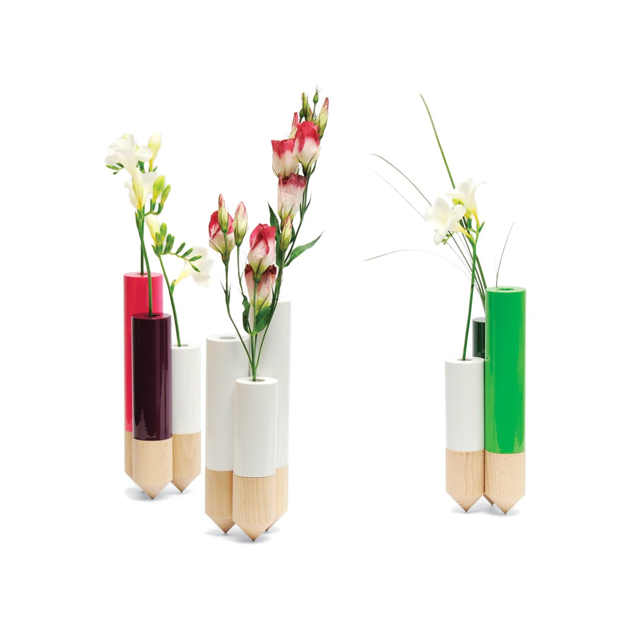 """Designed by FX Balléry and available through A+R, the Pik's three connected vases perform an understated balancing act, while cheery accent colors and pale wood nod to Nordic design.  Search """"lyngby vase"""" from Modern Vases in Metal, Glass, and Wood"""