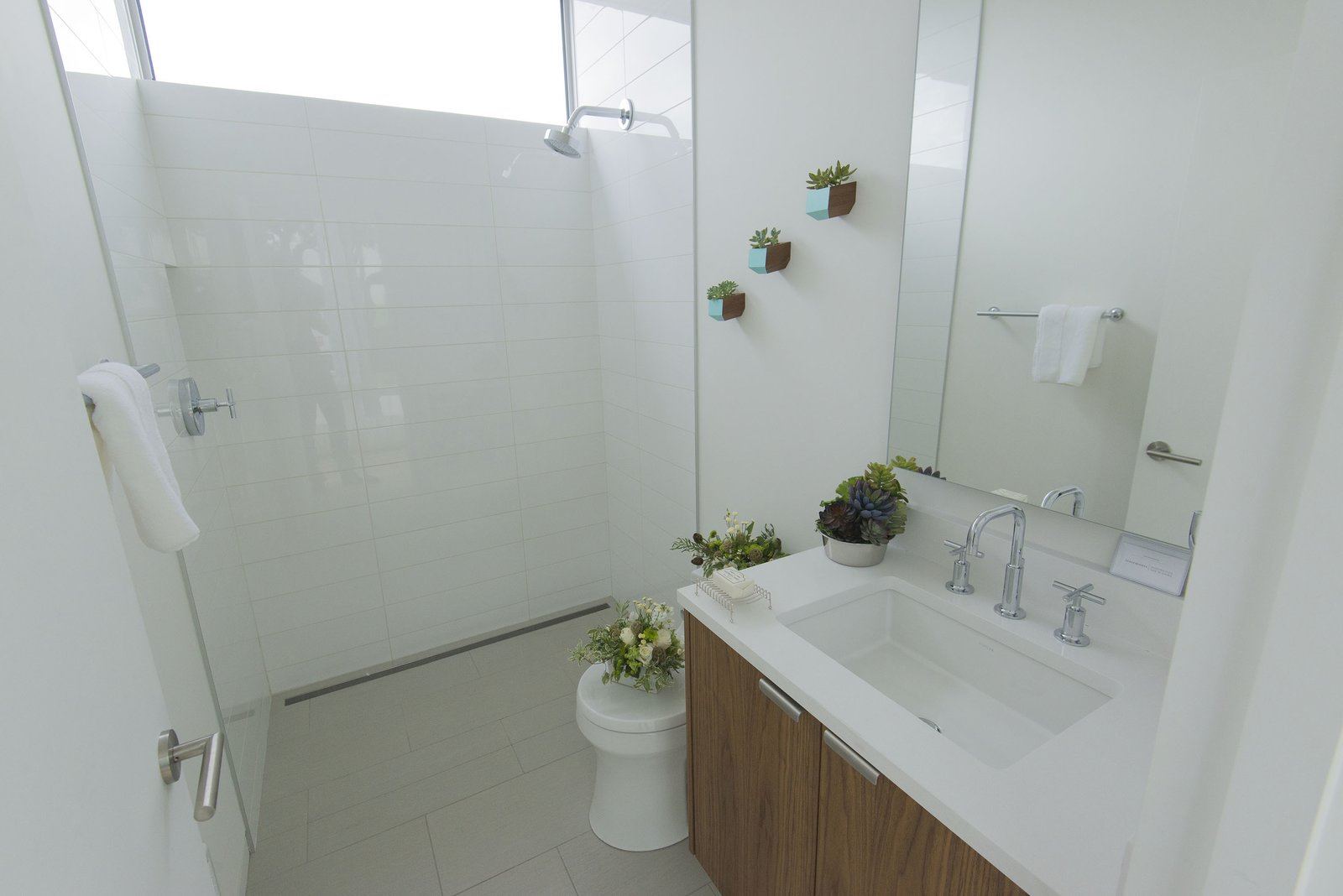 The wall and floor tile in the bathroom is from Statements Tile. The fixtures are Kohler.  Bathroom