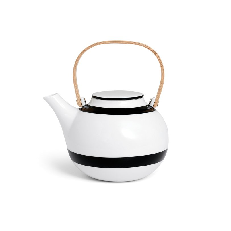 "This chic porcelain teapot from Danish designers Ditte Reckweg and Jelena Schou Nordentoft offers a streamlined, minimalist design with clean black and white graphics.  Photo 4 of 11 in 10 Ways to Bring a Little ""Hygge"" Into Your Home from Stylish Modern Teapots"