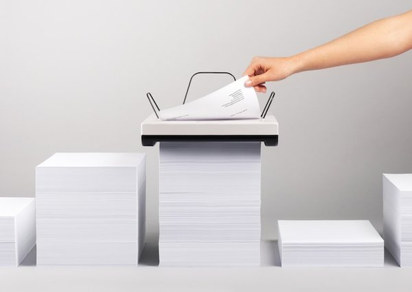 Printed sheets create a new stack of paper on top of the machine.   Photo by: Mugi Yamamoto