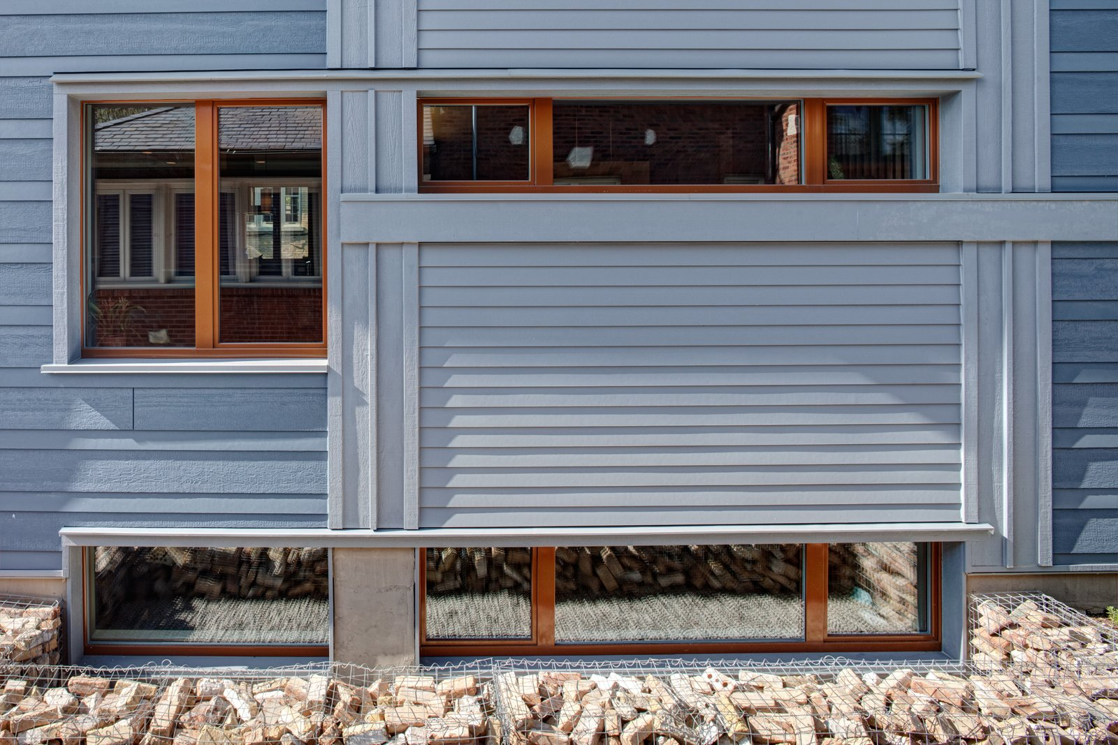 The south windows provide much of the winter-free heat as well as the opportunity to break down the wall's mass into a dynamic composition.  Photo by: Eric Hausman Photography  Photo 3 of 8 in Sustainable Living: Chicago's First Certified Passive House