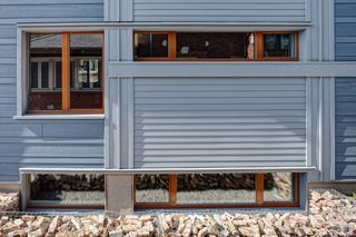 The south windows provide much of the winter-free heat as well as the opportunity to break down the wall's mass into a dynamic composition.  Photo by: Eric Hausman Photography