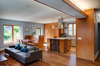 "The room above features flooring with Teragren bamboo, cork in the kitchen, and porcelain tiles at the entry points. American Yellow Birch was used for the cabinets and trim.<br><br><span style=""color: rgb(204, 204, 204); font-size: 13px;"">Eric Hausman</span>"