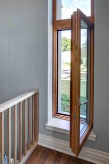 Aluminum-clad wood Zola European windows provide Passive House performance.  Photo by: Eric Hausman Photography