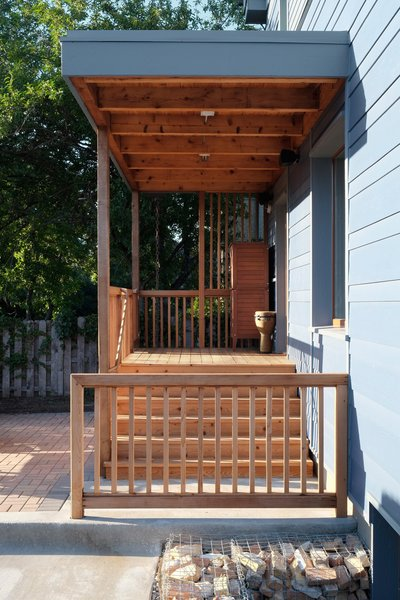 A cedar deck and beams create the transition to the back entry.  Photo by: Eric Hausman Photography
