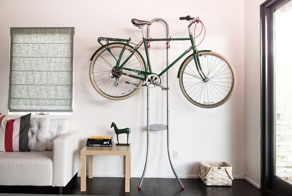 """Public Bikes' Michelangelo Two Bike Gravity Stand is perfect for when you have more than one bike and are short on space. The simple metal stand just rests against your wall—no mounts needed. There's an adjustable top and bottom rack, for you to store one or two bicycles of any shape or size, and lets you choose the heights at which your bikes rest.   Photo by: Public Bikes  Photo 7 of 9 in """"Where Should I Keep My...?"""": Solving the Ultimate Small Space Dilemmas from Smart Attractive Ways to Store Your Bike Indoors"""