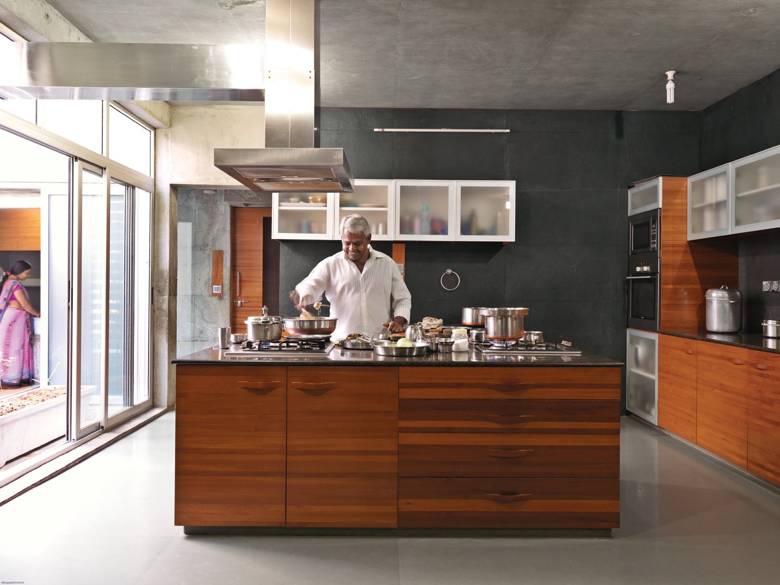 "Measuring 18,000 square feet, the house is composed of two linear wings and connected by the kitchen, otherwise known as the ""black box."" As in other areas of the house, the architect continued the limestone flooring.  Kitchen from More Cool Kitchen Islands"
