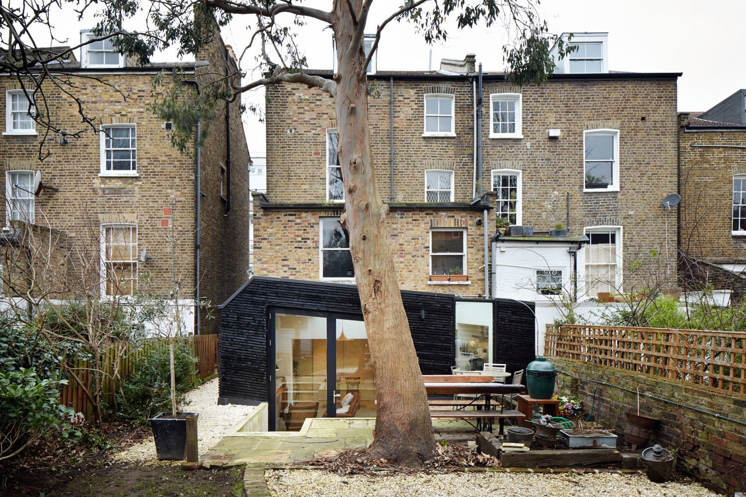 The renovation added a touch of modernity to the building without overwhelming it. The yard remains a work in progress, as the client is still working through ideas for a kitchen garden.  A Modern Addition Gives a London Chef a Dream Kitchen by Laura C. Mallonee
