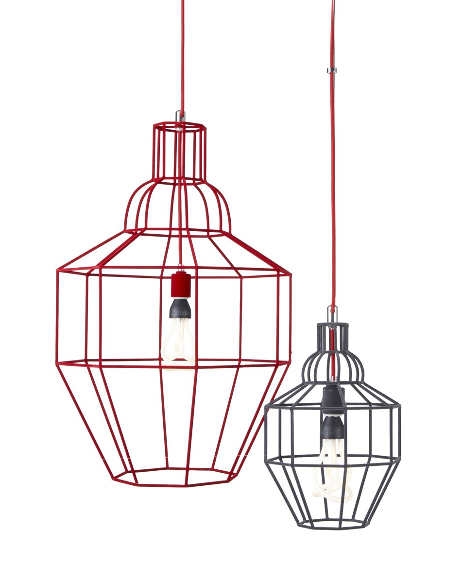 Riviera Large Red Pendant ($199) and Riviera Small Grey Pendant ($129) by Paola Navone Only at Crate & Barrel. These attenuated wire frames are just right for 2013, and the gray and red colorways add a subtle amount of color to a dining room.  60+ Modern Lighting Solutions by Dwell from Pieces by Paola Navone Only at Crate & Barrel