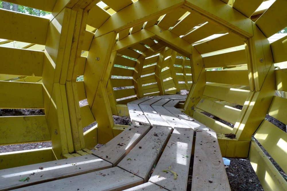 Inside the snake there is a long mazy tunnel in which children can hide from both each other and adults. The playground is located in a nature park, and the idea is to provide ways for children to experience nature.  Photo 4 of 8 in Imaginative Playgrounds by Monstrum