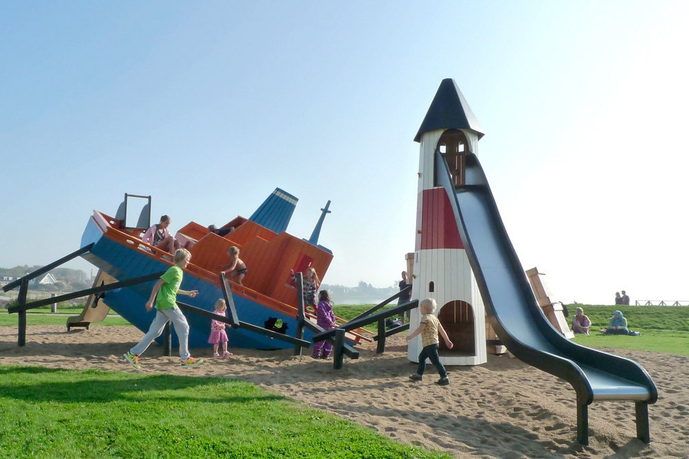 The Cargoship playground in Höganäs, Sweden, was developed in collaboration with the municipality as part of a general renovation of the area. It's theme, with a sunken ship, lighthouse and fish, is designed to fit into the maritime environment.  Photo 5 of 8 in Imaginative Playgrounds by Monstrum