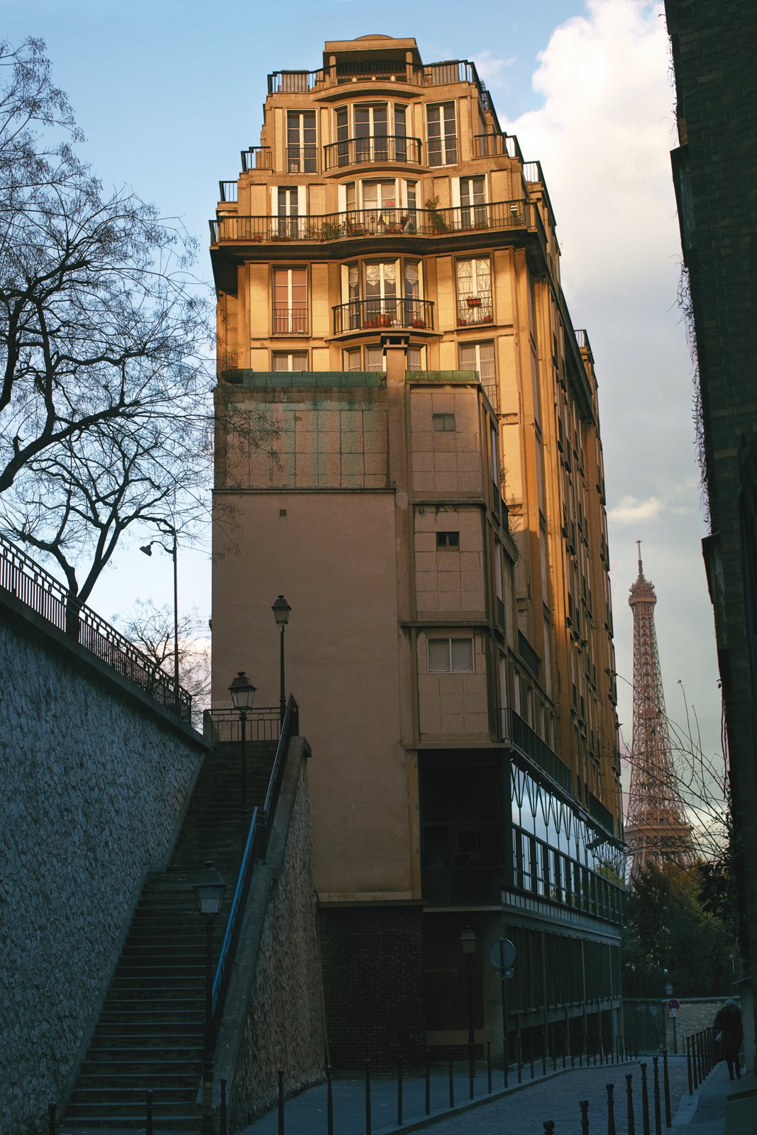 """The apartment building is a ten-minute walk from the Eiffel Tower.  Search """"madrid couple remake apartment one their childhood buildings"""" from Modern High-Design Pied-à-Terre in Paris"""