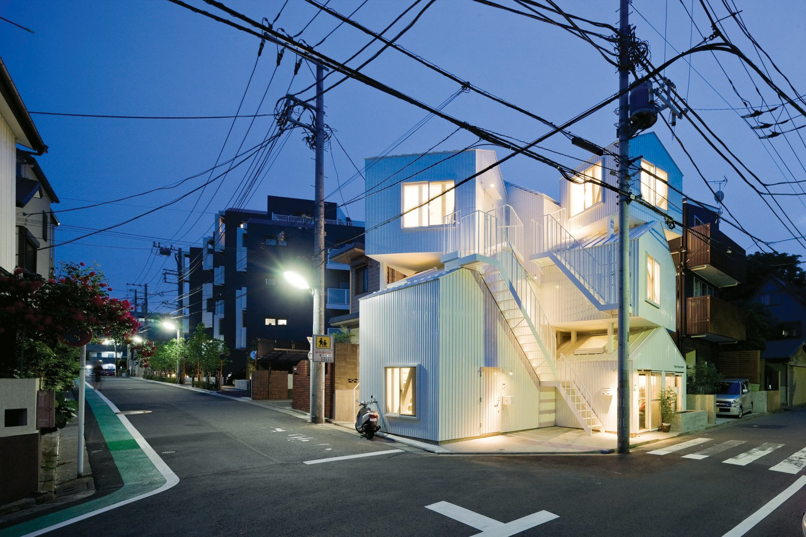 Resembling a jumble of houses piled on top of one another, the dynamic Tokyo Apartment building from 2010 evokes the chaos and crowding of Tokyo. Adding to the complexity, the dwelling units do not correspond to the house forms. Instead, stairs and ladders link individual tenant spaces that span the different pitched-roof volumes.  The building sits on a corner site amid a quiet residential neighborhood.  Photo 3 of 6 in Architect We Love: Sou Fujimoto