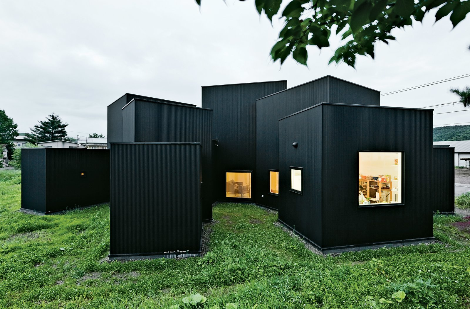 Exterior, Cabin Building Type, House Building Type, and Flat RoofLine House O, designed by Jun Igarashi, forgoes hallways and interior doors in favor of casually interconnected rooms.  Best Photos from Design Tips for Privacy