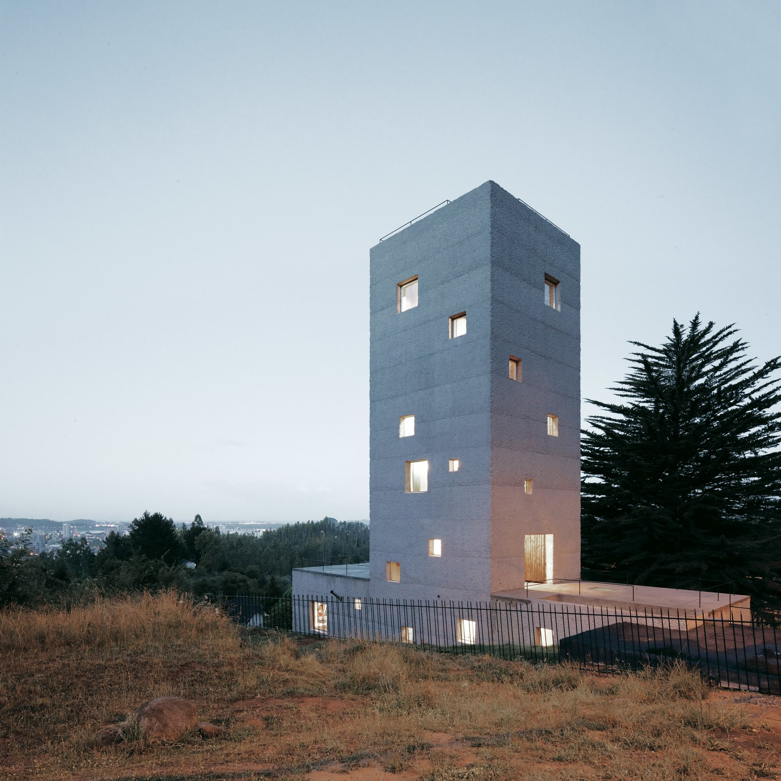 Sofia von Ellrichshausen and Mauricio Pezo's reinforced concrete home in Chile stacks rooms for working in a vertical column atop horizontally-oriented spaces for living.  Concrete from Design Tips for Privacy