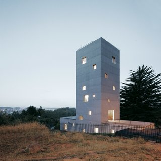 Sofia von Ellrichshausen and Mauricio Pezo's reinforced concrete home in Chile stacks rooms for working in a vertical column atop horizontally-oriented spaces for living.