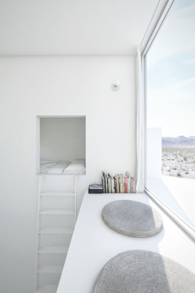 A bedroom occupies the top of each tower; a ladder leads to a sleeping nook and an east-facing window seat in the Sunrise suite.