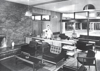 Robin and Lucienne Day   Churchill College at the University of Cambridge commissioned Robin Day for the first time in 1962 for dining room furniture. The results yielded additional projects for himself and his wife, Lucienne, a textile designer. Robin's black leather Club settees and armchairs and black vinyl–covered Interplan desks and tables still outfit the Senior Combination Room today.