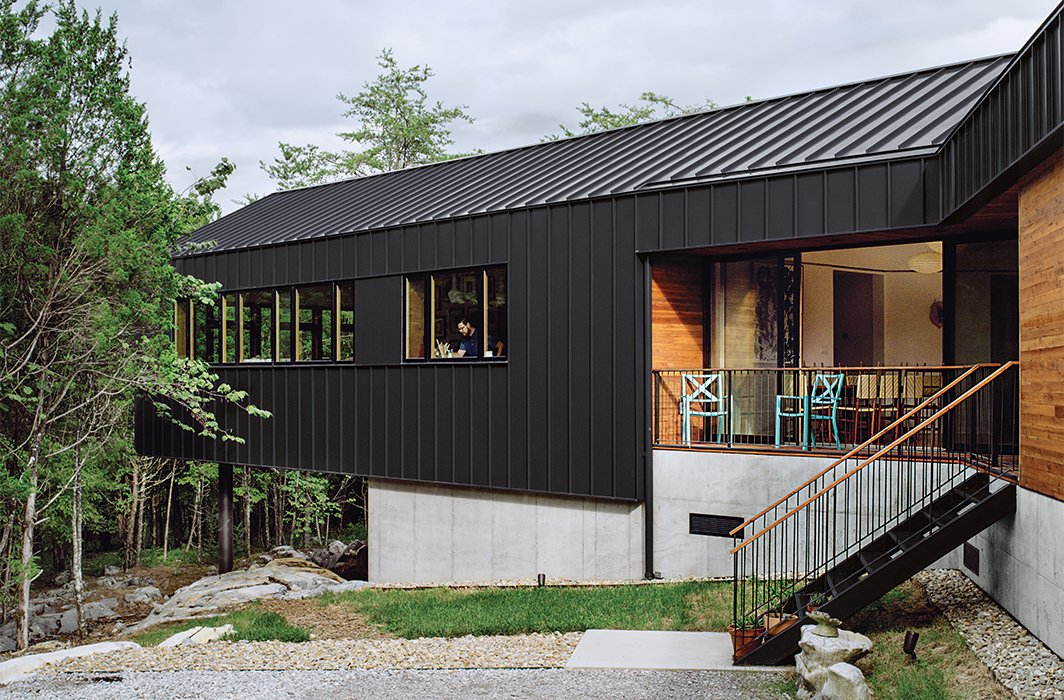 Exterior, House Building Type, Metal Siding Material, Gable RoofLine, and Wood Siding Material The living room wing cantilevers 26 feet off the main structure.  McHenry Creek from The Modern Home with Southern Charm