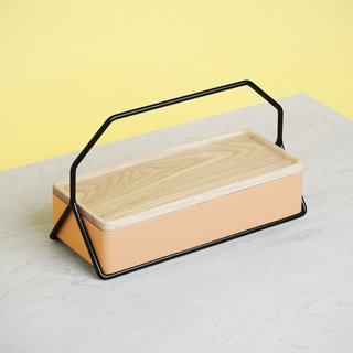The Nest Caddy is a versatile storage solution that can be used in several ways. The wood caddy can be used to store pens, pencils, jewelry, or even make-up. The caddy's lid can be used to conceal contents, or can be flipped over to hold additional items, or can be used as a tray. The metal holder can be used as its primary function—to transport the caddy—and can also be used to hold a tablet or display an art print.
