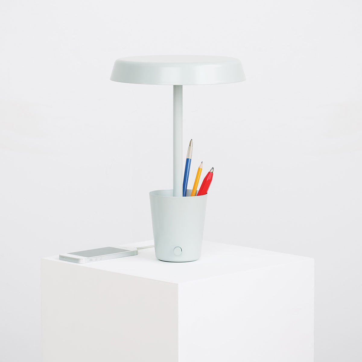 "With its simple profile, the Cup Lamp is an unexpected multitasker. In addition to its primary function as a dimmable LED lamp, the aptly named lamp includes a storage cup at the base of the lamp. Designed to hold pens and pencils or other small knickknacks, the Cup Lamp is ideal for a desk or bedside table.  Search ""pixo desk lamp graphite"" from Modern Designs from Umbra Shift"