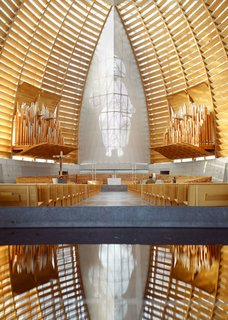 Oakland's Cathedral of Light, designed by SOM, is just a single-story building, but the gracious curves showcase the artistry possible with taller wooden structures. Reaching a height of 136 feet, the wood-and-glass sanctuary exudes a calming presence.