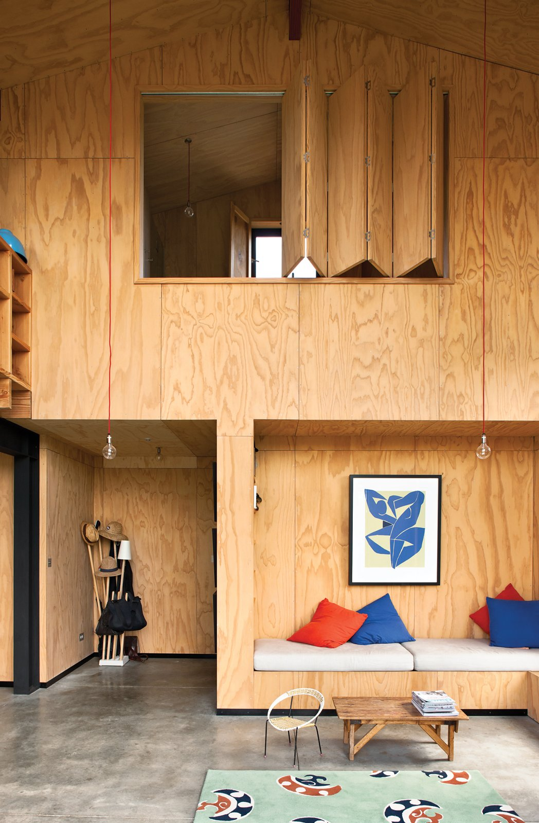 Instead of relying on plasterboard that would be too costly, architect Davor Popadich chose to use plywood to line his New Zealand home's interior. In addition to being cost effective, the plywood highlights the builders' craftsmanship. We think he made the right decision. See more on the Popadich residence here.  100+ Best Modern Seating Designs from Ways to Use Benches
