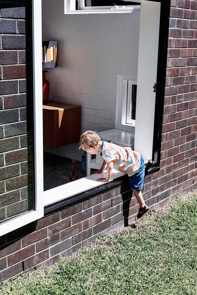 """""""It's a great house for a young family—playful, practical and different,"""" Tribe says. """"You can sit on the windowsill in the sun and feed the baby, kids can climb in and out, often through the windows, and you can see everything that is going on."""""""