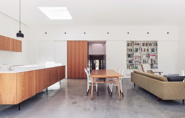 The clients had an impressive collection of Scandinavian midcentury teak furniture that now pops beautifully against the concrete floors, white-painted brick, and pine v-joint walls.