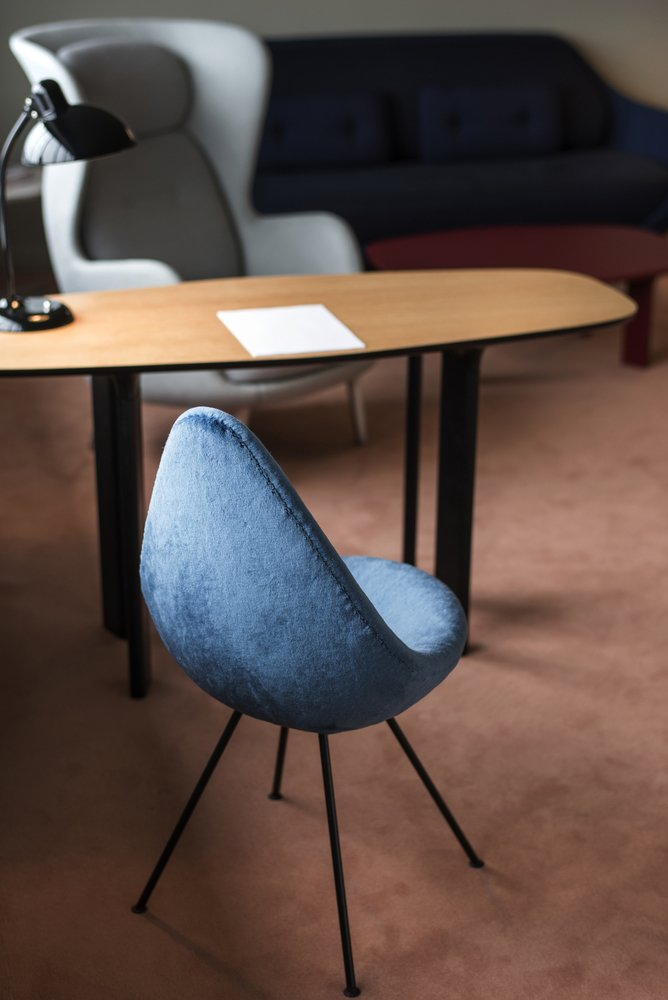 "A limited number of Drop chairs were made for the hotel, then production ceased. In 2014, Fritz Hansen revived the design. Hayon upholstered this particular one with bold, blue fur.  Search ""kitchensinks--drop-in"" from Jaime Hayon Reimagines a Room in an Iconic Copenhagen Hotel"