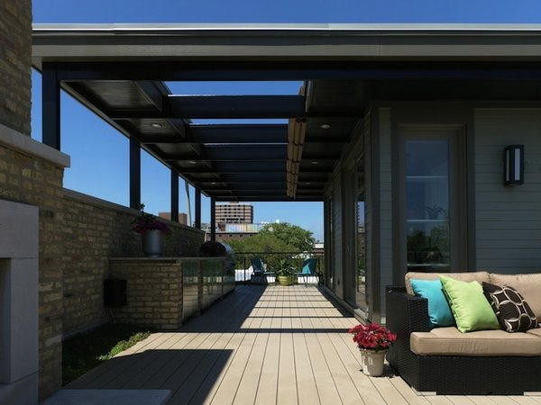 Urban Renovation (Foster Dale Architects)  Created from composite materials, the deck gives this modern home a desirable outdoor space in a crowded city lot.