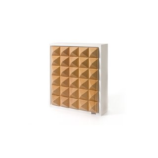 The simple Pyramid Key Box takes the clutter of keys and hides it in a geometric, wall-mounted cabinet. Inspired by traditional valet boxes, the Pyramid Key Box has six pegs for different sets of keys. When closed, the box becomes a work of sculpture, featuring thirty elegantly crafted birch pyramids. The box is framed in white, which will make the key box stand out against a painted wall.