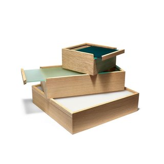 The ObjectBoxes from designer Maya Bille allow you to both store and display items in one simple step. Each European wood oak box includes an acrylic sliding lid that has enough transparency to reveal the box's contents, and enough opacity that the eye focuses on the color of the lid and the fine craftsmanship of the wood box.