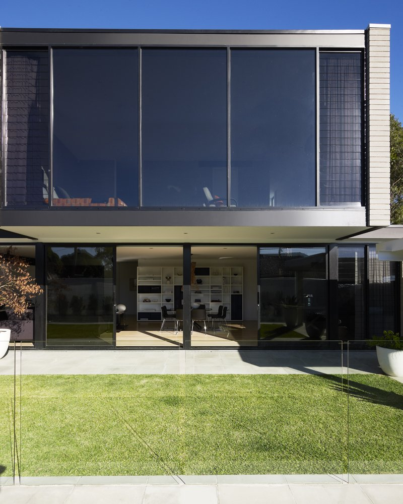 For the cantilevered second story, Natale selected black powder-coated aluminum frames for the floor-to-ceiling windows.  Photo 11 of 11 in Guide to the 5 Main Window Types You Should Know from A Modern Makeover Spared This Melbourne Home from a Teardown