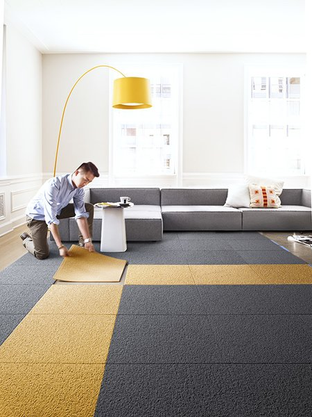 """Unlike traditional broadloom and area rugs, we're a modular system that allows you to create custom rugs, runners, and wall-to-wall designs to fit any size and shape,"" senior designer Cristina Englund says. ""With broadloom rugs, you have to replace whole sections of a rug at a time, but with FLOR you can pick up one square and clean it in the sink."""