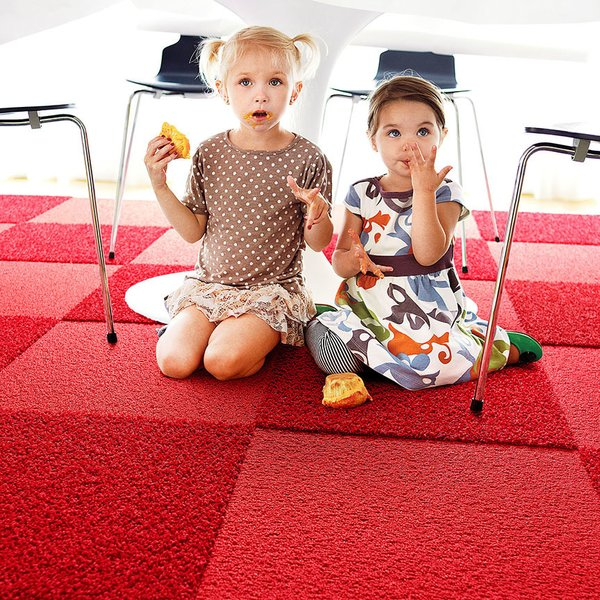 The tiles are designed to be impervious to moisture, and spills and stains won't seep through the carpet. For more information on FLOR, head to the brand's website.