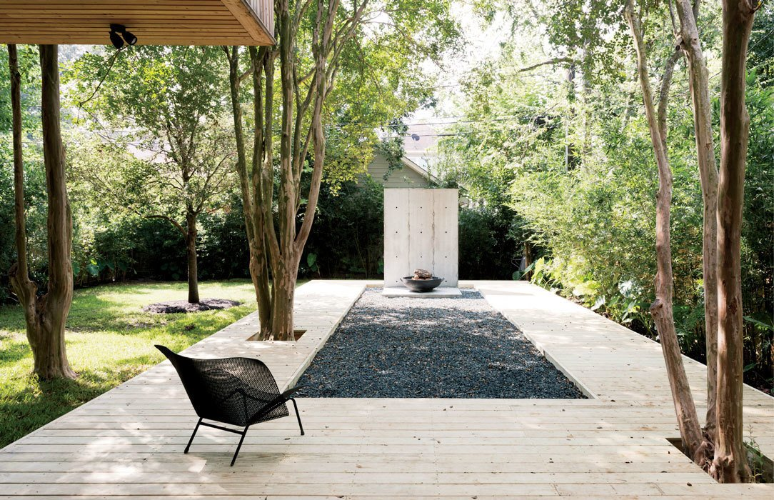 Outdoor, Large Patio, Porch, Deck, Wood Patio, Porch, Deck, and Grass The metal Grillage chair on the deck is by François Azambourg for Ligne Roset.  Photo 4 of 17 in A Texas Couple Builds Their Cast-In-Place Concrete Dream Home