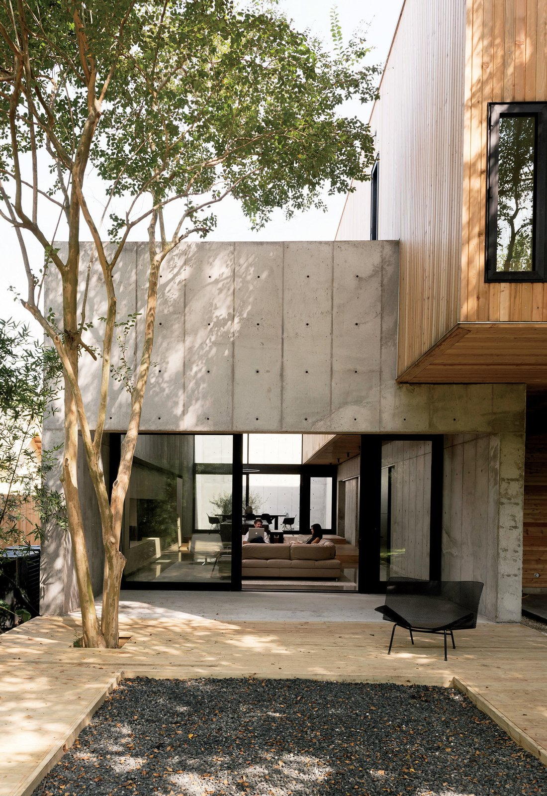 Concrete Box House backyard patio with cement and wood floors