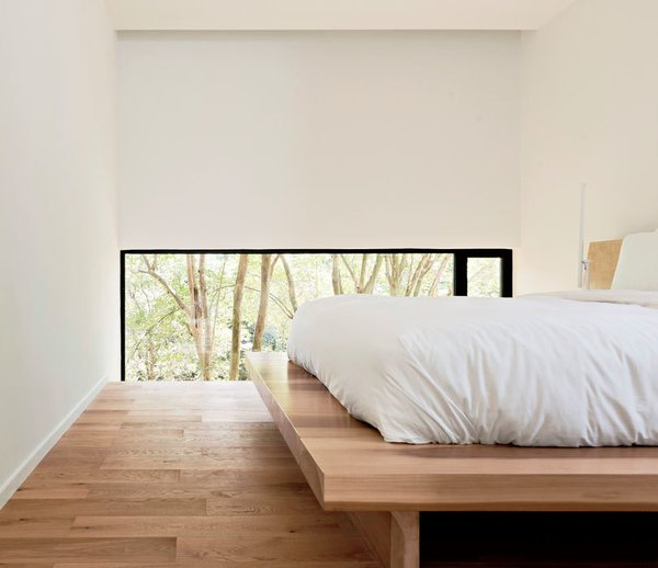The low windows in the master bedroom focus the view on the backyard, not the neighbors. Christopher designed the solid poplar platform bed.