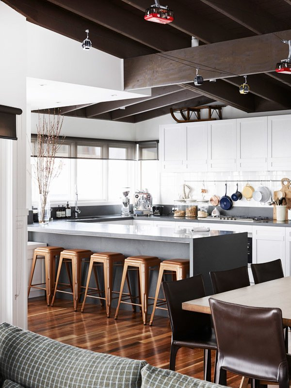 Kitchen, White Cabinet, Track Lighting, Dark Hardwood Floor, Range, and Wall Oven The Mt. Buller Home of Andrew and Tiffany Percy and Family via the Design Files.  INSPIRATION * WHITE from Australian Homes from the Design Files