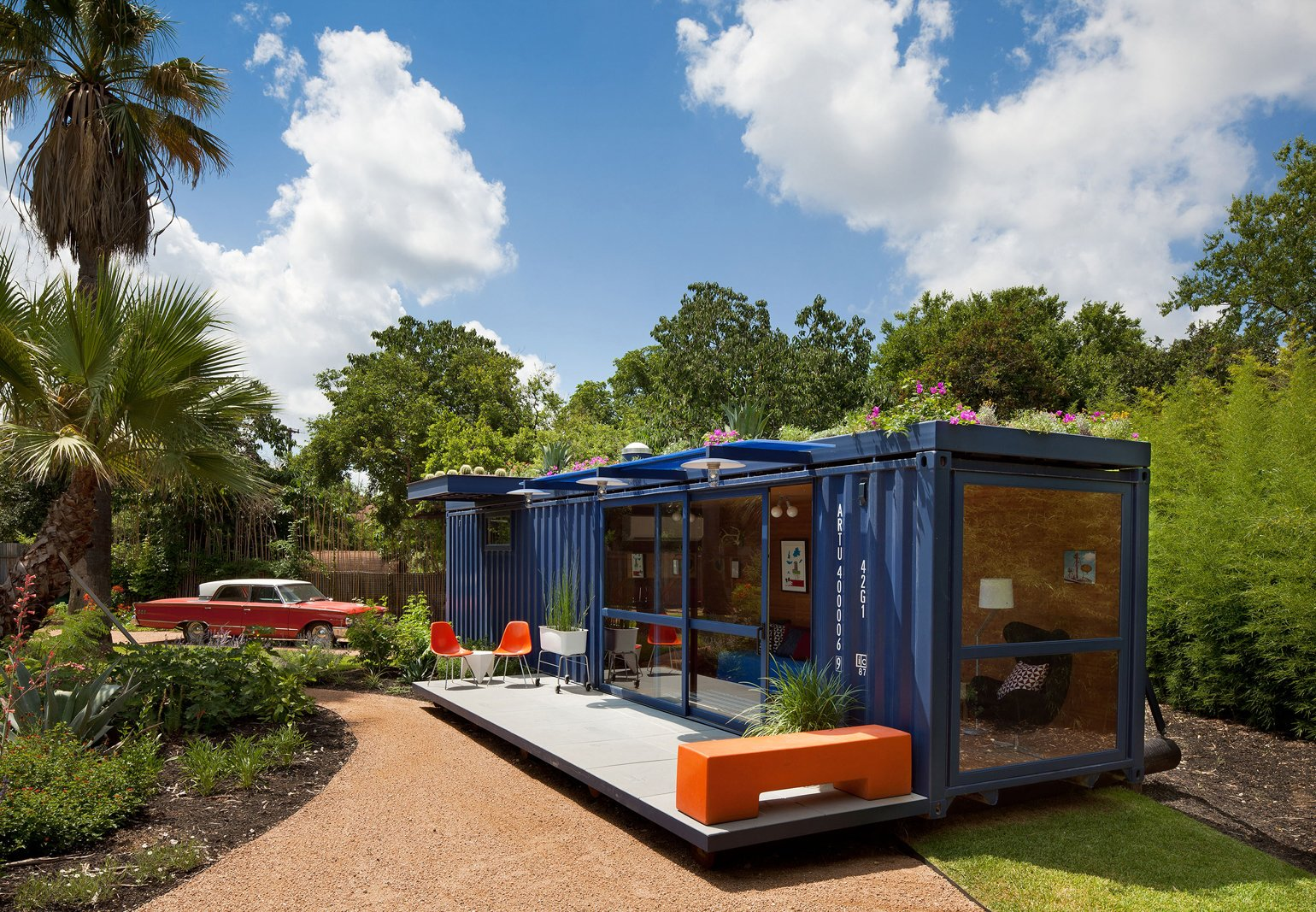 Texas architect Jim Poteet helped Stacey Hill, who lives in a San Antonio artists' community, wrangle an empty steel shipping container into a playhouse, a garden retreat, and a guesthouse for visiting artists. The container measures a narrow and long 8 by 40 feet; Hill asked that a portion of the square footage be retained as a garden shed and the rest serve as the living space.  20 Ideas On What You Can Do With Old Shipping Containers