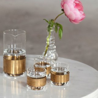 The Copper Chemistry Collection employs a sophisticated marriage of materials in glass and copper. The collection includes a carafe and glasses, and can be used as a set or individually.