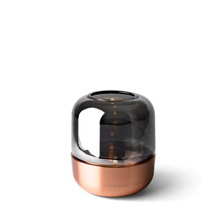 With a shiny copper-plated base and a mirrored luster glass cover, the Hurricane Lamp is a decorative element that looks sophisticated, whether or not the inner candle is illuminated. The mirrored glass reflects the hurricane's surroundings when the candle is not lit, adding dimension to the accessory.