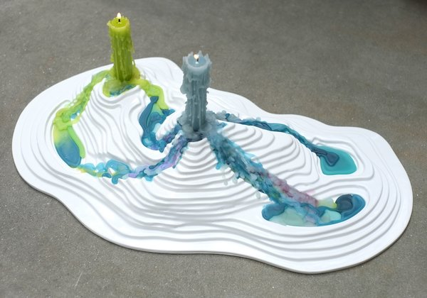 Posada also shares a topographic candle holder, pictured here.