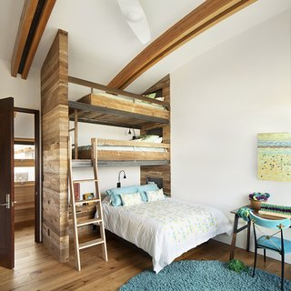 Compact bedrooms mean more space for communal areas. The room designed for the Conine's daughter boasts a custom three-level bunkbed for sleepovers. The wool rug is by Chandra, the bedding is by Coyuchi, the desk is by Misewell, and the chair is by Jonathan Adler.