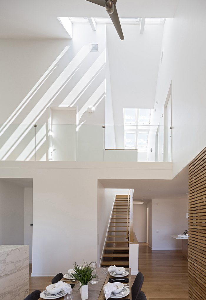 Motorized skylights by Velux, 14 in all, welcome natural light into the house.  Photo 2 of 4 in This Super Smart, Super Green Prefab May Be the Future of Suburban Living