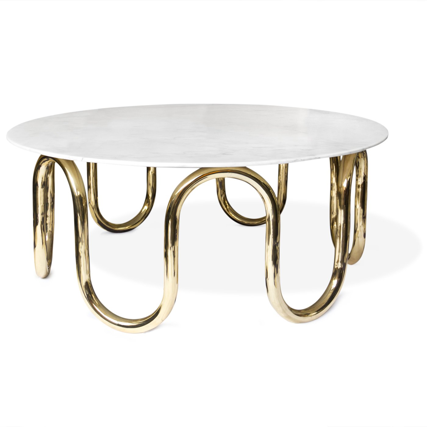 Adler's Scalintatella Cocktail Table was named for his favorite hotel in Capri. Carrera marble atop a hand polished brass base form a simple yet glamorous spot for drinks or magazines.  Photo 8 of 9 in Creativity and Constraint: A City Modern Preview