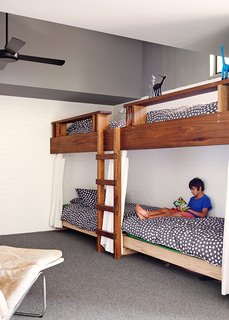 Made from Tasmanian oak, the bunk beds, covered in Kivet duvets by Marimekko, can accommodate four.