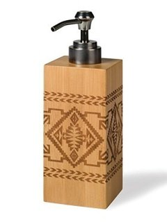 BAMBOO BASKET LOTION PUMP  Right on trend for fall, the Native American-inspired geometrics of this piece are laser-engraved on eco-friendly bamboo. We love the stainless steel pump with antique bronze finish.